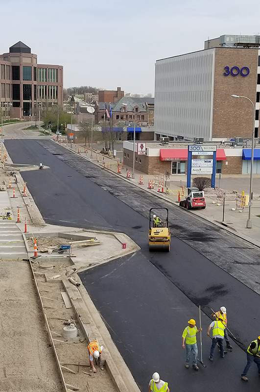 Workers pave street near Sioux Falls city downtown